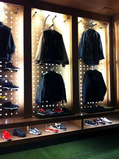 Nike's retail store in NYC. They used pegboard to display product. Love the industrial feel. More pics on the link.