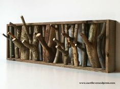 I found this unique wall hooks by tree branches by cantileverandpress on Etsy. the cantilever and press wolf den coat rack was designed for a dear friend to compliment his...