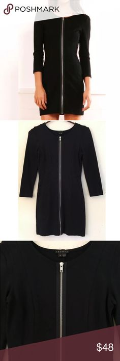 """THEORY Susan Sexy Zip Stretch Black Mini Dress • 50% virgin wool, 50% Lycra  • Silk lined • Functioning zipper in front center • 3/4 sleeves, scoop neck  • Underarm to underarm laying flat measures 15"""" unstretched, waist measures 12.5"""" across unstretched, shoulder to hem measures 32"""" • In great condition, a sexy and flattering little black dress! Theory Dresses Mini"""