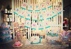 Lola's Shabby Chic dessert table.  Designed by her mommy Erica, paper goods by Papercandee, and photographed by Brooke Logue Photography.