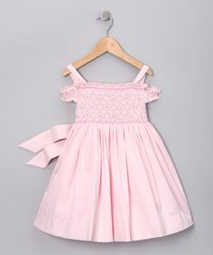 Petite princesses will simply adore this smocked dress. Featuring a dainty floral print and an off-shoulder silhouette, this effortless piece is more beautiful than a fairy-tale ending.65% cotton / 35% polyesterMachine wash; tumble dryMade in Peru