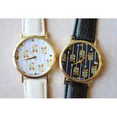 Reloj vintage con flechas de colores