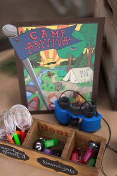 Camp favors including bug catchers, flashlights, and binoculars from Summer Camp + Camping Birthday Party from The Place for All Things Party--Kara's Party Ideas!