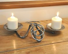 Hand Forged Double Candle Table Centre - This Hand Forged Double Candle Table Centre is lovingly crafted in a forge in Scotland. This is a unique product as each piece is forged individually meaning no one piece is exactly the same.