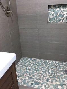 Large sliced sea green and white pebble tile shower floor with accent Pebble Tile Shower Floor, White Tile Shower, Bathroom Floor Tiles, Large Tile Shower, Floor Grout, Bathroom Showers, Shower Remodel, Diy Home, Small Bathroom