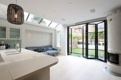 The Quarrendon Street project included a #four-pane #bifoldingdoor. They integrated a #trafficdoor by hanging one door leaf from the side frame which can act independently from the stack.