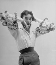 Bettina Graziani, 1952, wearing the 'Bettina Blouse' Givenchy named for her. Photo: Nat Farbman for LIFE magazine.
