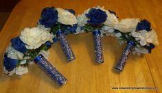 Blue satin with silver overlay handles at www.silkweddingflowersforless.com