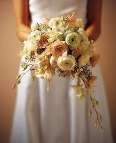 The bridesmaids will have similar bouquets in muted shades of ivory and pale pink with pops of bright green hypericum berries and buttons as well as orange astilbe and pink pepper berries.