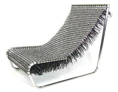 Carlos Alberto Montana Hoyos | Chair made from 1739 recycled aluminum can tabs weaved together with plastic pull ties.