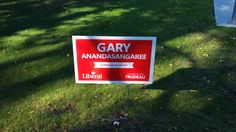 Old Kingston Road:  It's difficult for drivers and even passerby's to read a small sign.  To complicate the matter, having a long name (Anandasangaree) doesn't help your cause.  You would have more familiarity with your voters with at least a picture.  #TLDR, #TheHuntForRedOctober #elxn42