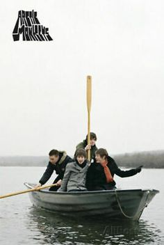 Poster featuring the four Arctic Monkeys in a boat. The Arctic Monkeys are Alex Turner, Jamie Cook, Matt Helders, and Nick O'Malley and all feature on this poster. Alex Turner, Arctic Monkeys Wallpaper, Monkey Wallpaper, Arctic Monkeys Album Cover, Poster Wall, Poster Prints, Monkeys Band, Alternative Rock, Alternative Music