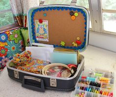 Jennifer Jangles Blog: My Craft Suitcase - she bought suitcase on Etsy and added cork board, plastic organizers with compartments, etc.