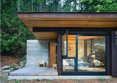 This beautiful forest retreat was designed by Olson Kundig Architects and is located in the North of the San Juan islands within the Salish Sea. It is a single room cabin, meant as a getaway for a bachelor