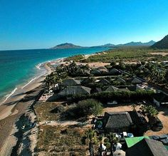 Cabo Pulmo Beach Resort is a small rustic romantic getaway village of Palm-thatched bungalows that are located right in front of the National Marine Park of Cabo Pulmo just 60 miles up the Sea of Cortez on the gulf side of Baja Mexico.