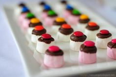 marshmallows, dipped in chocolate, with an m&m; on top...wouldn't these be great in cocoa?