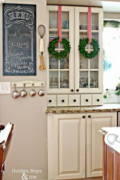 Cute wreaths hanging to bring holiday cheer in the kitchen.   Golden Boys and Me: Holiday Home Tour 2014