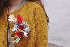Vintage corsage pinned to a cozy sweater.
