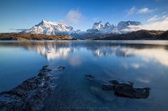 """Pehoe Reflection - The Cuernos Del Paine covered with snow, reflecting on the calm Pehoe lake on a cold, still April day. We'll be spending 4 full days shooting in Torres Del Paine on my upcoming '<a href=""""http://www.erezmarom.com/index.php/photography-workshops/view/giants-of-the-andes-patagonia-photo-workshop"""">Giants of the Andes</a>' Patagonia photo workshop. The workshop is already starting to fill up quickly, so if you're interested, check out the workshop webpage for all the details…"""