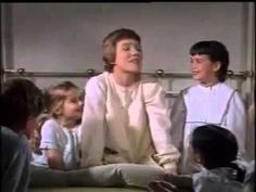 """My Favorite Things - Julie Andrews   Sound of Music""                                  This song has the power to make me smile! :)"