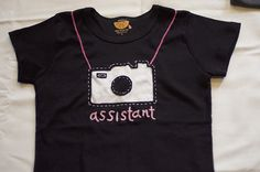 I want one of these photog assistant shirts for me. CUTE!