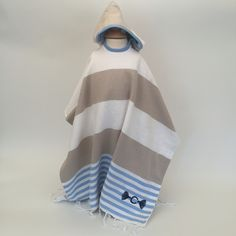 "Hooded poncho with Camilla tassel monogram, size ""child's"" one size fits most children."
