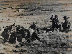 British paramedics attending a wounded Argentine soldier under fire, Mount Longdon, Falkland Islands, 1982