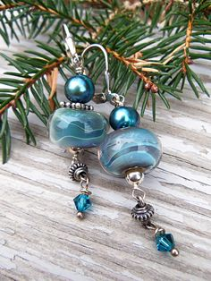 Smooth Waters Handmade Lampwork Earrings: These earrings began with my own lampwork glass beads in soothing blues, grays and teal.  I've accented the glass with freshwater pearls in blue spruce, Bali silver beads, Swarovski crystals and sterling silver beads and leverback earwires.