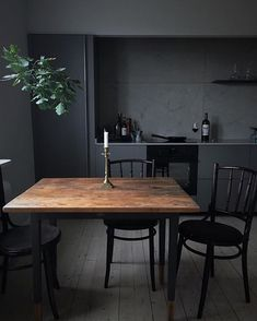 This dark, moody kitchen is steeped in atmosphere. Looks like something from the set of a complicated drama.