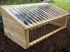 A cold frame is a protective covering and passive solar-energy collector for growing plants when cooler temperatures outdoors can adversely affect plants. A cold frame protects the plants from… Greenhouse Shed, Small Greenhouse, Greenhouse Gardening, Veg Garden, Garden Beds, Cold Frame Gardening, Polycarbonate Panels, Best Solar Panels, Garden Structures