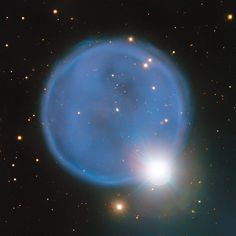 This image shows the remarkably round planetary nebula Abell 33, located roughly 2500 light-years from Earth. The strikingly bright star, HD 83535, located along the rim of the nebula creates a beautiful illusion in this VLT image. The star lies in the foreground of the nebula, between Earth and Abell 33, in just the right place to make this view even more beautiful. - Image Credit: ESO - Image enhancement: Jean-Baptiste Faure