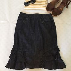 """Flash SaleAnthropologie Ruffle Hem Denim Skirt oh so cute dark wash ruffle hem skirt from Pilcro and the Letterpress for Anthropologie. Features ruffle detail at hem and button detailing at front pockets. Side zipper with hook/eye closure. 100% cotton. waist is 13.5"""" flat and length is 21"""". size is a 00 but please match waist measurements to other skirts you own to ensure proper fit. Anthropologie Skirts Pencil"""