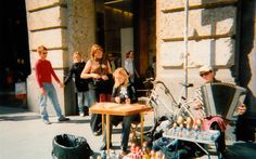 That's me behind the right shoulder of the hammered dulcimer player.  This was taken in the square near Il Duomo.