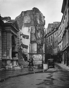 Girls dancing in the streets of Paris, 1950s.amidst the WW II damageby Robert Doisneau