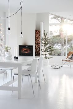 The sleek simplicity of white transforms a home completely. Pops of contrasting colors like charcoal and black create depth and warmth. Photo by Elisabeth Moors