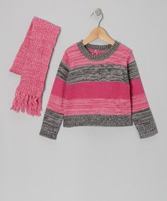 Coordinate with cozy comfort by dressing little ones in this delightful duo. Boasting a stylishly striped sweater and a tassel-trimmed scarf, it's the perfect look for keeping cuties warm and toasty.