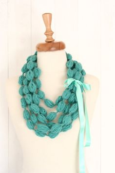 Long strands of yarn tied off into bubbles for this adorable scarf.