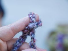 Swirl thin strip into circle.  Use thread to attach and to keep its shape.  Poke twig through the back.