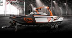 Tige RZ4 - We've raised the bar—again. The RZ4, the flagship of the RZ Series, is the ultimate expression of our vision.  With a powerful combination of razor-sharp styling and a luxurious interior, its performance isn't the only thing that will be admired.  Only Tige's patented Convex V hull can produce the surf wave on both sides of the boat -- easy for any style rider to ride either way.