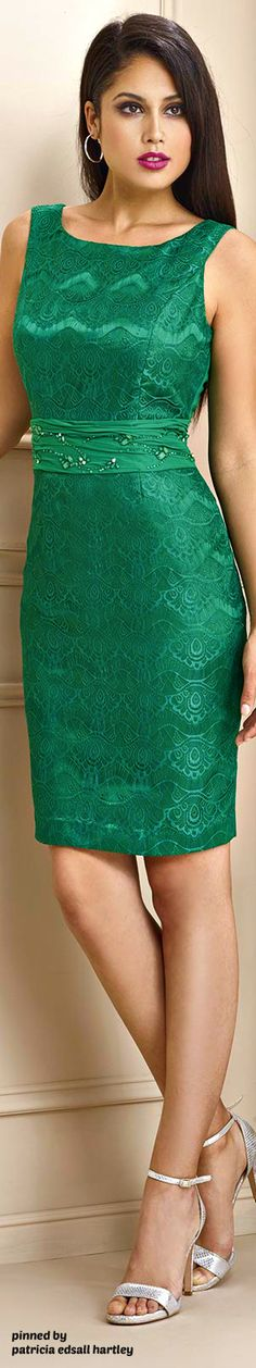 Lightly tanned magenta-lipped dark chocolette in emerald embroidered muscle sheath dress
