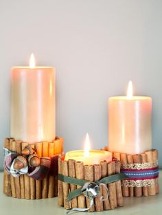 Bring holiday charm to basic pillar candles with cinnamon sticks.