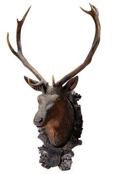 Tête de cerf en bois sculpté