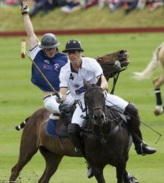 Celebrating: Prince William and Prince Harry pictured during today's Festival of Polo at the Beaufort Polo Club in Gloucestershire.