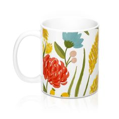 Wildflowers abound on this coffee mug made for sipping your morning coffee while watching the mornin