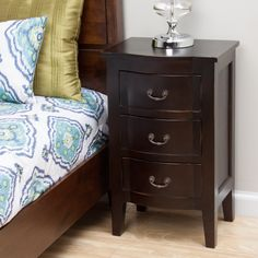 Featuring a warm, rich espresso finish, this beautiful nightstand was handcrafted by Indonesian artisans of solid mango wood. Complete with three drawers of ample storage space, this elegant nightstand will complement any bedroom motif.