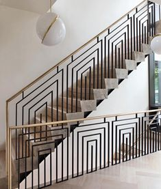 An Art Deco dream? The angular, geometric metalwork instantly throws you back to the and perfec - Interior Design Examples Staircase Railing Design, Modern Stair Railing, Balcony Railing Design, Modern Stairs, Staircase Architecture, Metal Railings, Railing Ideas, Staircase Ideas, Interior Design Studio