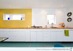Use high-gloss surfaces in your next interior design project for a beautiful modern design.   18 Beautiful Designs of Kitchen Remodels | Home Design Lover