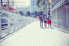 Three people of family walking bayside walk royalty-free stock photo
