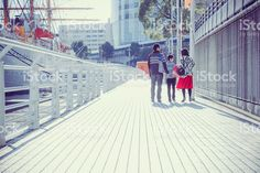 Three people of family walking bayside walk royalty-free stock photo
