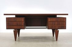 Rosewood desk designed by IIlum Wikkelso. Manufactured in the 1950's most likely by Eilersen.